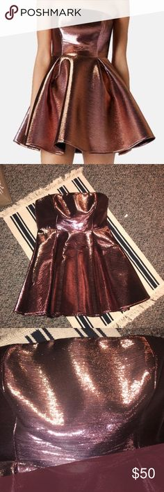 TopShop Metallic Strapless Dress Super cute metallic dress it is an almost pink color! Perfect for any occasion! It has a long exposed zipper in the back! Topshop Dresses