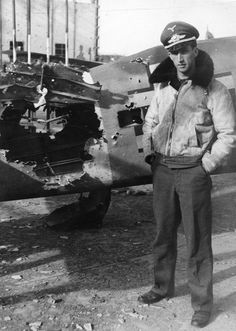 Focke Wulf pilot posing , with his plane - after a really really close call