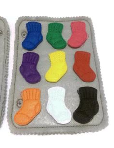 This listing is for 2 felt matching sock game pages color matching quiet book pages. The socks fit inside the washing machine and on the second page you will be