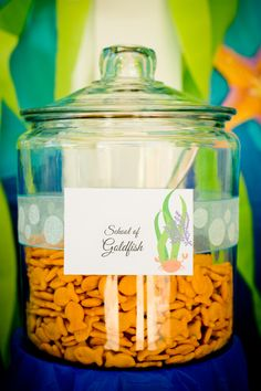 "Goldfish crackers in glass container for ""sea"" theme graduation party."