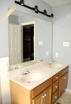 They wanted to update their ugly mirror without removing it. Look what they did instead: