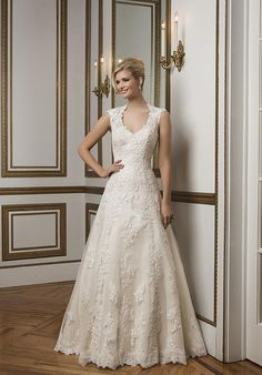 Classic A-line gown with a Queen Anne neckline features hand placed beaded lace and point d'esprit underlay | Justin Alexander | https://www.theknot.com/fashion/8822-justin-alexander-wedding-dress