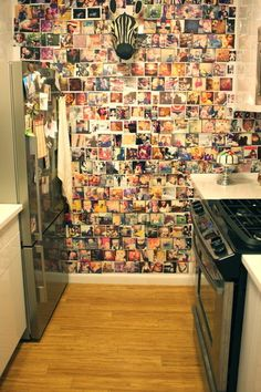 an impromptu collage instead of wallpaper, a combination of Polaroids, Instagram prints and other photos.   by nat the fat rat on Houzz