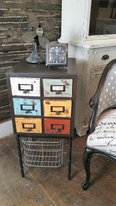 Vintage Card Catalog Table BEFORE&AFTER - WOW we took a vintage library 6-drawer card catalog and mounted it on a metal base then painted each drawer front , distressed and aged it, added the vintage wire basket to the bottom lined all the drawers.....and now an awesome repurposed One-of-a-kind side table!!! Can you see this as a cool night stand? In the family room or even at the door to stash all the small things like keys. Heading to our shop tomorrow