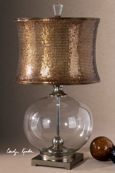Clear glass body with polished chrome metal details and bronzed burnishing. The round modified drum shade is made of mesh sequins finished in a copper bronze