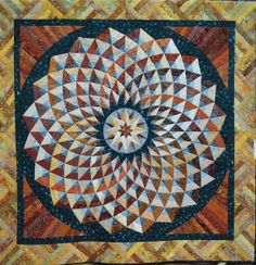 This circular pattern is from Bella Bella Quilts by Norah McMeekin