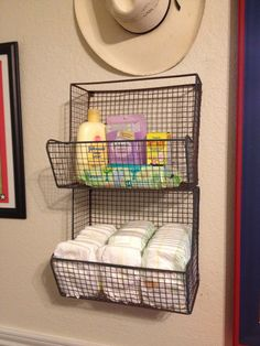 Texas Cowboy Nursery - Two wire baskets purchased at Hobby Lobby make great diaper storage. Felt protectors were added to the back to protect the wall from wear and tear. Great Granddaddy's hat is a sweet reminder of a wonderful man!