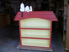 Snoopy Doghouse Bookcase.... What I want in Benjamin's room. Hopefully before he is a year old.