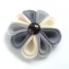 This Harlequin Corsage has been created from nine petalsof subtly contrasting felt in shades of grey and cream and has been decorated with a shiny black faceted button. Soft and sophisticated, this folded felt accessory will make a welcome addition to . Cloth Flowers, Felt Flowers, Diy Flowers, Fabric Flowers, Paper Flowers, Felt Crafts, Fabric Crafts, Felt Hair Accessories, Wedding Accessories