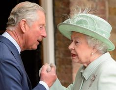 Queen Elizabeth II greeting her son Prince Charles at the Chapel Royal at St. Jame's Palace to before attending a service for members of the Order Of Merit 14 May 2013