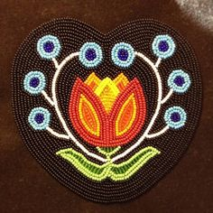 Fully beaded medallion or hair tie,  beaded and designed by Jessica Gokey 2013