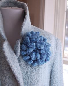 5 by 1 1/4 inch - bet it's made with the same wool yarn that is used to felt
