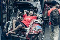 Becak driver taking a break on Jalan Malioboro, Yogyakarta, Indonesia