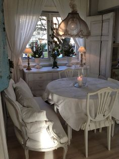 Vintage look for a small eat in area with French love seat banquette
