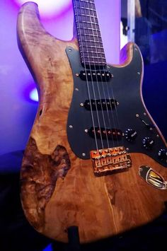 Beautiful wood grain art on this Fender Stratocaster eectric guitar with black pickguard. DdO:) - https://www.pinterest.com/DianaDeeOsborne/instruments-for-joy/ - INSTRUMENTS FOR JOY. Note that the controls are up with the pick guard. Photo pinned via brakerthe1st. #Strat