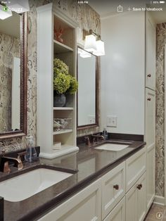 2-light fixtures over vanity. White painted cabinets. Square sink. Love mirrors.