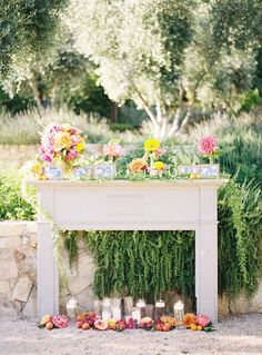 Love the pictures mixed in with the flowers, I want something similar on the mantle at my wedding