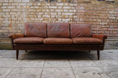 Brown three seat leather sofa by Skipper | CHASE & SORENSEN // DANISH MODERN FURNITURE & HOME DÉCOR