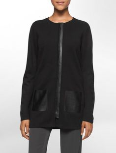 faux leather pockets add an edgy detail to this long zip front sweater.