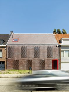 Yves Borghs and Katleen van Ammel wanted their new house to offer maximum privacy but also maximum light. The solution proposed by Tom Verschueren, of Mechelen, Belgium-based DMVA Architects, was to create a closed street-side facade with an open backside facing the garden, totally glazed from the ground up to the saddleback roof. photos by: Frederik Vercruysse
