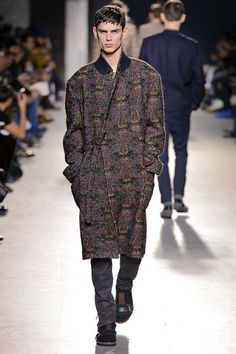 """""""The Morning After"""" was the theme of Dries Van Noten's Fall 2013 men's collection. Taking pajama dressing to a new level, he showed paisley PJs and lounging robes--like this one--with disparate day wear for that """"I-just-threw-it-on-and-made-my-escape"""" look."""