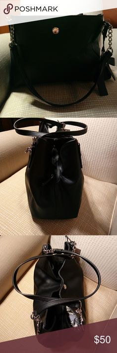 * New List*  NWT Nine West Purse Beautiful black medium Nine West bag that I just bought last Friday out of town. Looks and feels like leather but made of man-made materials. Lots of room with inner zip pouch and two larger outside pouches, magnetic closure. Nine West Bags Satchels
