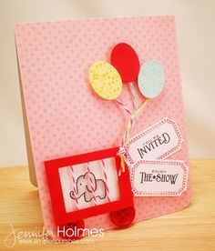 """Is the circus cage too sad? Otherwise a cute card, with party balloons and a """"ticket"""" to the party attached"""