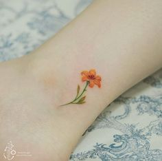 Floral ankle tattoo by Silo