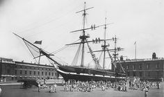 "Royal Hospital School training ship ""Fame"" with boys climbing the rigging. Date: 1901-50"