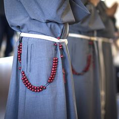 The gray habit of the Franciscan Friars of the Holy Spirit represents the call the penance. The cord they wear around their waists has three knots that represent the three vows they took: poverty, chastity and obedience. The red rosary represents the color of their community's patron — the Holy Spirit. (Billy Hardiman/CATHOLIC SUN)