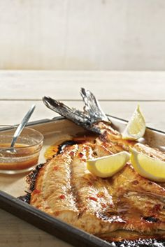 South African Snoek Fish With Apricot Jam _ Recipe from Martin van Deventer _ Snoek is delicious with a touch of sweetness and a mild spice like cumin. Try it in the oven or braai it outside. Read Recipe by Braai Recipes, Fish Recipes, Seafood Recipes, Cooking Recipes, Recipies, Fish Dishes, Seafood Dishes, Fish And Seafood, South African Dishes