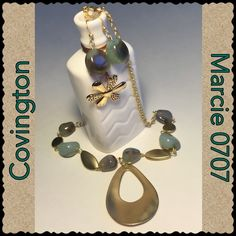 Beautiful green quartz necklace set by Covington This beautiful necklace and earring set is beautiful Green Quartz. It fits just right around the neck and has extra chain to make longer or shorter Covington Jewelry Necklaces
