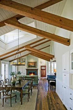 open, loft-like, eclectic, airy, country chic, beams, wainscoting