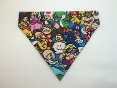 Custom Nintendo Character Pet Accessory -This fabric available in BANDANA only. -All pet accessories are made with 100% cotton fabric. -BANDANAS slide over your pet's existing collar. -All have coordinating, solid-colored fabric on the underside (unless you select the Double-Sided Bandana Add-On). -All come in a variety of sizes for every pet breed (see below for sizing information) Please note: - Since each item is handmade, placement of fabric pattern will vary depending how the fabric…