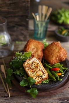Deep-fried Stuffed tofu **Tahu isi** these are vegan w an egg free batter. I bake mine w/o batter instead of frying, sometimes I use per fried tofu bits I get from any Asian market. I like to stuff w mushrooms.