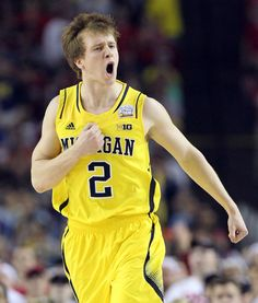 Curtis Compton Michigan guard Michael Spike Albrecht reacts to hitting a 3-pointer in the first half.