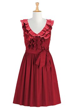 I <3 this Victoria dress from eShakti  -  black or red, ruffled neck and top/bodice, full pleated skirt, sash, elastic back, classic, pretty, dressy.  check out the entire site, nice clothes with tailoring available, decent prices, fast service, very large size range.        lj