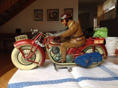 tipp&co tin toy motorcycle germany 1932-1936 30 cm.With the odd red luggage rack no 694