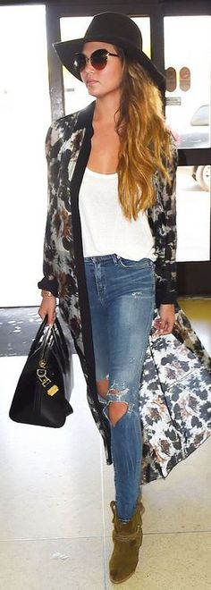 Chrissy Teigen: Sunglasses – Chloe  Purse – Givenchy  Shoes – Isabel Marant
