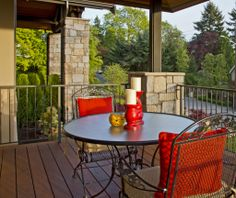A quaint and colorful outdoor seating/eating area with views of nature. Bellevue, WA Coldwell Banker BAIN $3,385,000