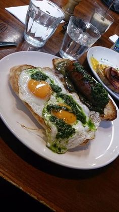 Mr Tulk cafe, Melbourne - special of the day which is 2 fried eggs, green capsicum, chorizo on sourdough bread topped with basil pesto. Looked like a snail had pood all over my egg but it tasted amazing, very filling #food #cafe #breakfast