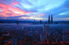 Kuala Lumpur, Malaysia. Glowing city lights, like banked embers soon to flare again with the coming sunrise.