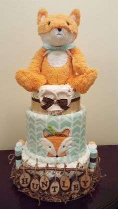 Woodland Fox diaper cake. Woodland themed baby shower centerpiece gift. Check out my Facebook page Simply Showers for more pics and orders. Thanks Kim