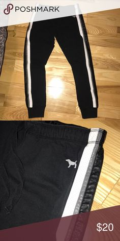 PINK VICTORIA'S SECRET SWEAT PANTS Black sweatpants with a leather-like material down the side.  Free beauty sample with every purchase! PINK Victoria's Secret Pants Track Pants & Joggers