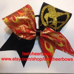 Hunger Games Cheer bow-Glitter gold, shiny yellow, shiny red and black cheer bow Hunger Games Party, Hunger Games Fandom, Hunger Games Catching Fire, Cute Cheer Bows, Big Bows, Cheer Quotes, Sport Quotes, Cheerleading Bows, Cheer Dance