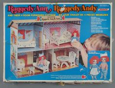 Raggedy Ann & Andy Dollhouse with wooden furniture.