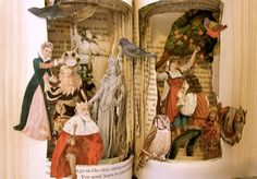 altered vintage book, images are cutted and placed like if they are playing in the book and want to go out, WOW