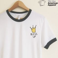 "Bless up!   Our ringer tees are a staple to any girl's closet, adding a touch of  grunge. They look great styled casually with jeans and boots, or dressed up  with a cute plaid skirt.  Unlike other Poly-Cotton t-shirts on the market, ours is made with combed  cotton, giving it an ultra soft, worn in feel and superior drape.   AMERICAN APPAREL WHITE RINGER TEES  Poly-Cotton (50% Polyester / 50% Ring-Spun Combed Cotton) construction  Sizing is American Apparel's Unisex Size S  Length : 28""…"