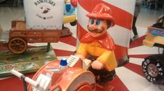 I found mario as a fireman rifing a machine for kids here in argentina