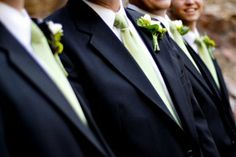 green ties on groomsmen